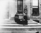 Three women on the steps of a large house_thumb.jpeg