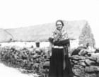 Aran woman with house in the background_thumb.jpeg