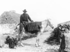 Aran man on horse with panniers_thumb.jpeg