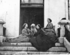 Three women and a dog on the steps of Clonbrock House_thumb.jpeg